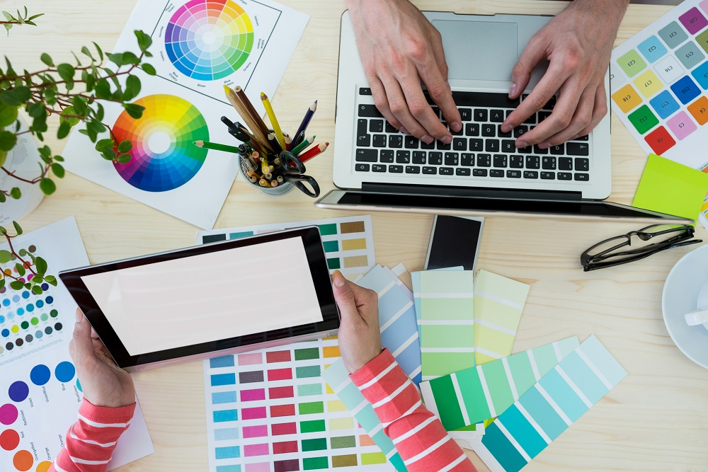 Hands Of Graphic Designers Using Laptop And Digital Tablet In Office